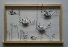 Aquarium,poissons,galets et fil recuit ... This piece of rock and wire art is wonderful!!