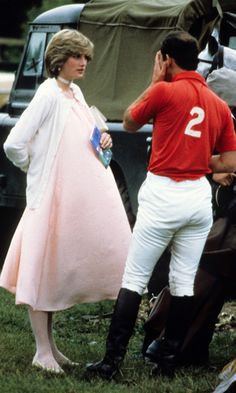 A very pregnant Diana camouflaged her baby bump in a pale-pink, billowy dress paired with a white cardigan for an outdoor polo event in 1982.