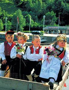 These children are wearing bunad, the traditional style of Norwegian clothing (post the Viking era). Each area of Norway has its own version.