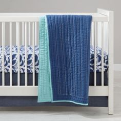 If you're looking for the deepest sleep your baby will ever have (actually, we make no guarantees), look no further than our Deep Blue Bedding.  The crib fitted sheet features scores of printed sea creatures and the reversible quilt is navy on one side and light blue on the other, so you can give your crib a new look every day.  Designed exclusively for us by Banquet Workshop.