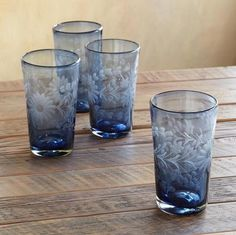 Serene sipping assured, with flowering tumblers handcrafted in Mexico of recycled glass, mouthblown and etched on the grinding wheel. Sundance.