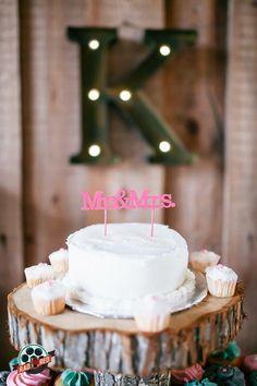 Adorable Mr & Mrs cake topper!   Photo by Rad Red Creative www.radredcreative.com #makeyourweddingrad #weddingphotography #bouquet #redbouquet #tampaphotography #tampaweddingphotography #tampawedding #tampaphoto #cake #weddingcake #caketopper #countrywedding #rusticwedding