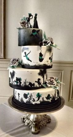 Disney Silhouette Wedding Cake by Storyteller Cakes - http://cakesdecor.com/cakes/221192-disney-silhouette-wedding-cake