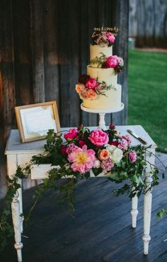 Romantic peonies covered three tiered wedding cake; Featured Cake: The Cake and I