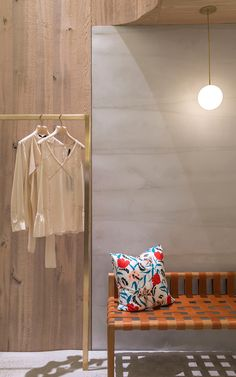 Curved concrete walls patterned with subtle layers feature in the inaugural store for fashion brand Thakoon, located in New York's SoHo district.