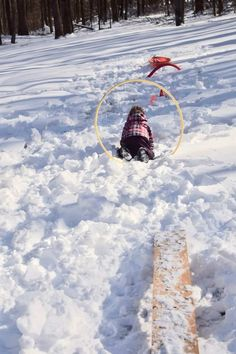 Ideas for a fun outdoor winter obstacle course for kids. This obstacle course contains awesome gross motor activities for kids that will get all of their cooped up energy out. It's the perfect snow day activity.