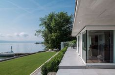 Lake side house with glass walls. Lake View, Architecture, Sidewalk, Exterior, Windows, Landscape, Glass Walls, House, Corner