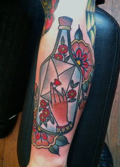 tattoo old school / traditional nautic ink - hand with love letter / bottle inside