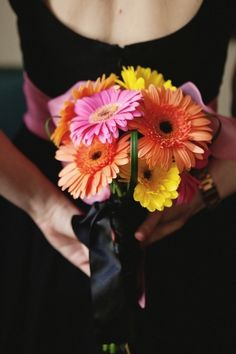 Bright wedding flowers for bridesmaids. Gerber daisy bouquet pink orange and yellow