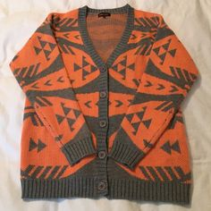 Coral and Grey • Tribal • Cardigan Fully buttons down the front. V neck. Coral and grey tribal pattern. Never worn, perfect condition. 100% acrylic. Boutique Sweaters Cardigans