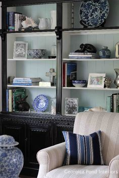 Living Room - Georgica Pond. Very large black bookcase/hutch with soft blue painted back.