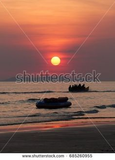 fun at the beach at sunset in rayong Thailand