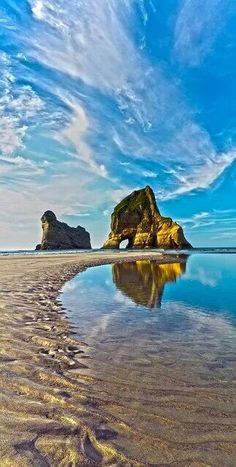 Wharariki beach new Zealand  http://www.travelandtransitions.com/destinations/destination-advice/australia-south-pacific/travel-new-zealand-auckland-christchurch-wellington-the-southern-alps-and-lots-of-beautiful-nature/