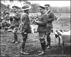 Sir John Monash presenting a decoration to a soldier in the  Australian Imperial Force after the Battle of Le Hamel in 1918.