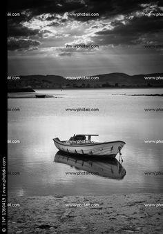 http://www.photaki.com/picture-treto-boat-in-the-sunset-ra_1360419.htm