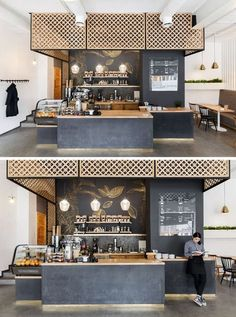 Central to this modern coffee shop is the service area with dark walls and a concrete base. Wood screens, countertops and decorative gold artwork compliments the look. - This Ukrainian Coffee Shop Has Touches Of Gold Throughout Coffee Shop Counter, Cafe Counter, Coffee Bar Home, Coffee Shop Bar, Coffee Art, Coffee Mugs, Cafe Shop, Cafe Bar, Kaffee To Go
