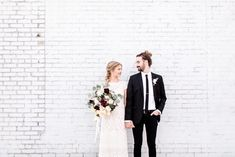 We love this couple's minimalist + edgy wedding style | Image by Natalie Broach Photography #weddingphotoinspiration #weddingphotoideas #weddingportrait #couple #cutecouple #coupleportrait #couplestyle #groomstyle #bridalfashion #bridalhair #bridalbouquet #weddingbouquet