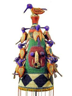 Yoruba, Beaded Crown, Nigeria. Traditionally, Yoruba crowns were worn by the king, or Oba, in public ceremonies. They were embellished with symbolic designs. Beads were signs of wealth and status.
