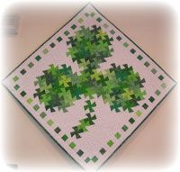 Shamrock Twist Quilt Pattern by Handcrafts by Jennifer at KayeWood.com. Make a wonderful wall hanging for St. Patrick's Day. http://www.kayewood.com/item/Shamrock_Twist_Quilt_Pattern/3043 $9.00