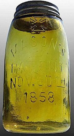 Mason's, Cross Above, Patent Nov 30th 1858, Olive Yellow, Quart.A quart olive yellow cross over Mason's Patent Nov 30th 1858 glass fruit or canning jar
