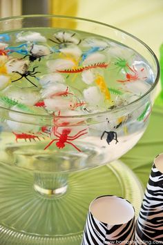 Freeze plastic bugs in an ice cube tray for fun & creepy drink effect! Via bombshellbling.com #partyideas #halloweenparty #halloween #drinks ★Halloween Party Drinks ★ Halloween Beverages ★ Halloween Party ★ Insect Party★ Creepy Crawler Party★Repin | For other refreshing Halloween Party Themes Ideas, check out: www.partyplanningsolutions.com