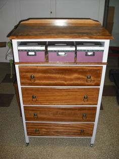 This is dresser that was on it's way to the dumptser. I striped the top and draw fronts replaced one side that was broken. Then I painted the body. Moved the top draw to the bottom and turned the top opening in a storage are. I found the pulls on ebay...