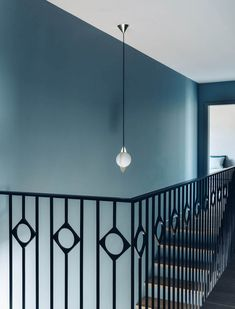Stair rails in black metal - Pattern design - Blue walls - Villa bleue, Nyon – Valentine Bärg Architectures