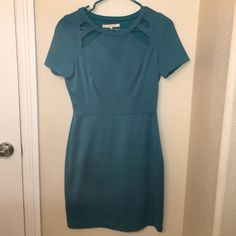 Halston Heritage cutout dress Halston Heritage cutout dress. Teal color. Cutout details at the neckline. Classy enough to wear to work, fun enough to wear out. Stretchy material. Worn once. No damage. The Halston tag needs stitched back on one side, but I don't know how and don't want to stitch through to the back. Halston Heritage Dresses Mini