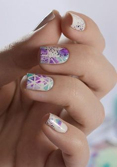Violet and blue watercolor nail art design. Paint violet and blue polishes on your nails while adding various diagonal white lines forming a pattern on top. For effect you can add violet silver dust.