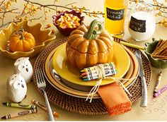 Rattan Charger • Dishwasher-safe Yellow Essential Colours Dinnerware with pieces from the Red, Yellow & Green Boxed Dinnerware Set • Pumpkin Soup Bowl with Lid • Dishwasher-safe Chalk Notes Drinkware • Machine-washable Ric Rac Napkin • Ceramic Leaf Bowls • Owl Salt & Pepper Set