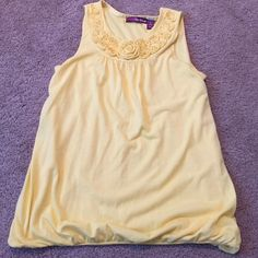 Epic Threads Sleeveless Yellow Roses Tank Used but hardly worn Epic Threads Sleeveless Yellow Roses Tank with a cinched bell bottom. Runs more like a large. Epic Threads Tops Tank Tops