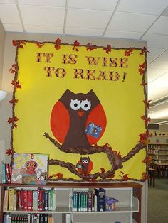 """It is Wise to Read!"" owl library bulletin board"