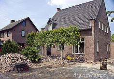 A detached house being renovated, new bricks are being laid in front of it.  <a href='http://www.dreamstime.com/interiors-rcollection5192-resi208938' STYLE='font-size:13px; text-decoration: blink; color:#FF0000'><b>HOME BUILDING & RENOVATION »</b></a>  <a href='http://www.dreamstime.com/my-holland-collection-rcollection7089-resi208938' STYLE='font-size:13px; text-decoration: blink; color:#FF0000'><b>More Dutch houses »</b></a>