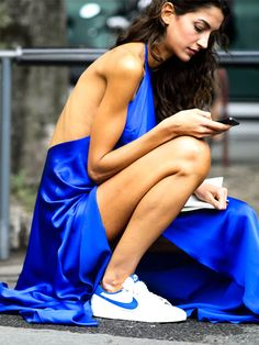 A blue gown is worn with unexpected Nike sneakers