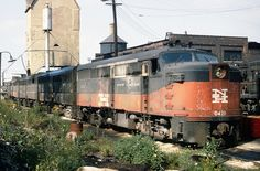 New Haven Railroad ALCO DER-2a FA-1 & DER-2b FB-1 locomotives are seen in a four unit set, led by FA-1 # 0421, on a loco storage track in the yard at Maybrook, NY, late 1950's, Mac Seabree Collection by alcomike43, via Flickr