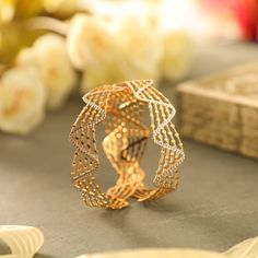 The golden illusion. Get these and more such quirky treats at our ongoing Plain Gold Bangles, Gold Bangles Design, Gold Earrings Designs, Indian Jewelry Earrings, Hand Jewelry, Gold Jewellery, Jewelery, Manubhai Jewellers, Gold Wedding Jewelry