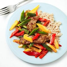 Caribbean Steak and Vegetables with Coconut Rice: Whisk together 3 tablespoons pineapple juice; 2 tablespoons fresh lime juice; 1 garlic clove, minced; 1 teaspoon grated fresh ginger; 2 teaspoons honey; 1/4 teaspoon crushed red pepper flakes; and a pinch of salt.    Add sirloin and peppers -Done  Cook instant brown rice in light coconut milk.