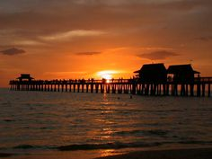 Naples Florida.  I can spend hours on the pier watching the dolphins and other wildlife.
