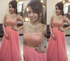 Trisha Krishnan dolled up in a stunning floor length peach gown by Mrinalini Rao. Party Wear Maxi Dresses, Gown Party Wear, Long Gown Dress, Lehnga Dress, Indian Designer Outfits, Designer Dresses, Indian Gowns Dresses, Net Dresses, Baby Dresses