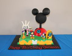 Mickey Mouse Clubhouse Cake - Buttercream 9x13 sheet cake.  Half soccer ball covered in MMF for clubhouse.  Mouse head and ears made of styrofoam.