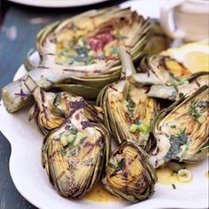 This recipe gives you the option to either boil or grill the artichokes for a side dish that replaces potatoes. The tarragon drizzle complements both cooking methods.