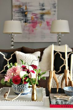 Beautiful candlesticks and tapers add statuesque glamour while a small, delightful tray brings the eye back down to the rest of the action . Design by Kristin Cadwallader of Bliss at Home