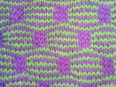 Knitted using 'Mosaic knitting ' method, knitting one colour at a time and slipping stitches to make the blocks.