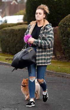 Morose: Make-up free Perrie Edwards looked glum as she took her dog Hatchi for a walk... a...