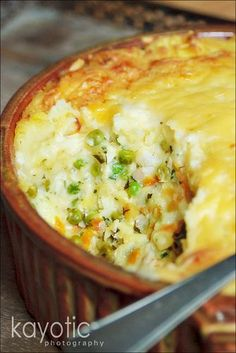 Mashed potatoes: 1 1/2 pounds potatoes roughly 2/3 cup of milk little knob of butter salt,pepper, nutmeg Fish & Vegetable: 14 oz white fish 1 1/2 cup milk 2/3 cup vegetable (or fish)broth 1 1/2 cups green peas 1 small onion 3 cloves 1 bay leaf 1/2 tsp salt 1 large carrot 1 lemon flat-leaf parsley cheese White Sauce: 5 tbsp all-purpose flour 3 oz butter 1/2 a tsp salt white pepper