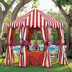 Love this. You can also decorate a regular white tent with red and white curtains to get a simikar look.