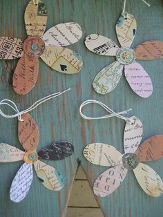 Inspiration: recycle old postcards, music sheets, maps, bingo cards etc. into flower gift tags.