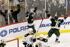 Minnesota Wild forward Chad Rau left celebrates with Marco Scandella after scoring on Boston Bruins goalie Tim Thomas during the second period of an NHL hockey game Sunday Feb. 19 2012 in St. Wild News, Boston Bruins Goalies, Tim Thomas, Minnesota Wild, Hockey Games, Sports News, Scores, Nhl, Period