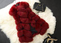 http://www.aliexpress.com/item/New-2014-Winter-Coat-Women-Fashion-Import-Overcoat-Whole-Peel-Fox-Fur-Vest-High-Grade-Cappa/32215187907.html