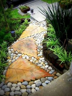 We all love a garden path, whether winding or straight. Neat as a pin or overgrown with plants, backyard garden paths lead our eye through a garden, and add charm and focus as well. However, building a walkway adds so… Continue Reading → Garden Paths, Garden Art, Walkway Garden, Rock Pathway, Front Walkway, Diy Garden, Best Garden, Garden Hedges, Terrace Garden